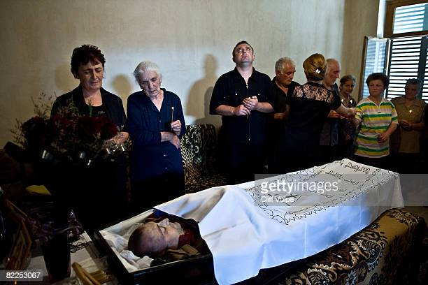 Relatives mourn the loss of Georgi Makridze a 30yearold Georgian soldier who died during fighting on August 9 in Tskinvali South Ossetia August 11...