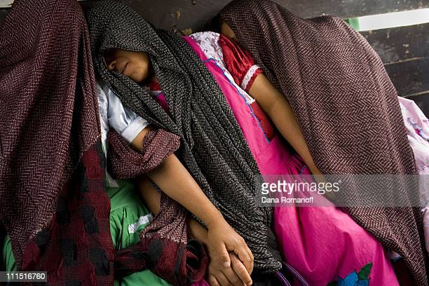 Relatives Naomi, Juliana and Ester Cruz Cruz comfort each other in the back of a truck on February 22, 2008 in Tlacolula. The women are returning...