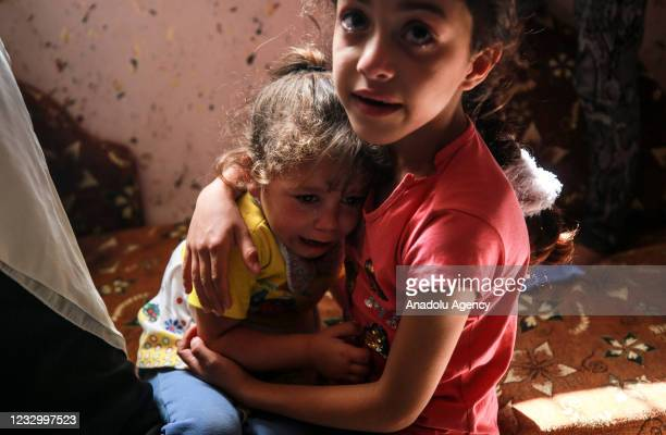 Relatives of 11-year-old Deema Asaliyeh, who was killed on Israeli attacks, mourn during her funeral ceremony at Jabalia refugee camp in Beit Lahia,...