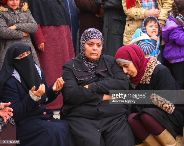 Relatives of 16yearold Ali Amr Qino who was killed in clashes with the Israeli army that erupted in the village of IraqBurin south of the West Bank...
