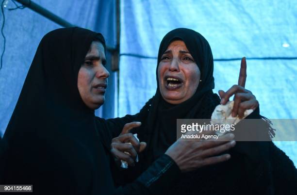 Relatives of 16yearold Amir Abu Mosaed who was killed after being shot in the chest in clashes with the Israeli army that erupted in the village of...