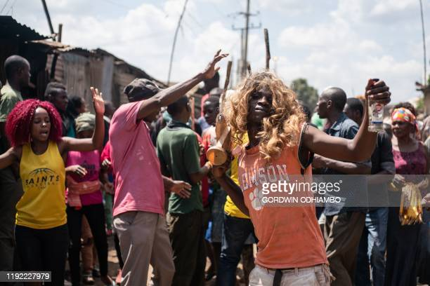 TOPSHOT Relatives of 18yearold Isaac Namolo from Gisu tribe celebrate his circumsicion on a street at Kibera slum in Nairobi Kenya on January 6 2020