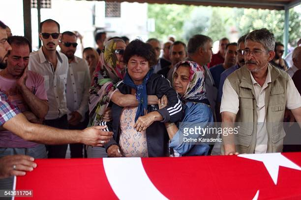 Relatives of 27yearold flight officer Gulsen Bahadir a victim of yesterdays attack on Istanbul Ataturk airport mourn at her Turkish flagdraped coffin...
