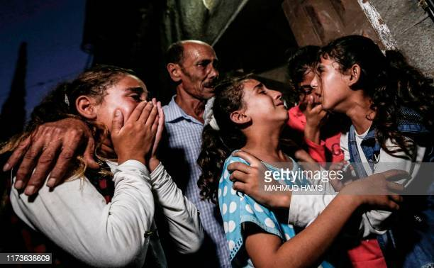 TOPSHOT Relatives of 28yearold Alaa Hamdan who was killed earlier by Israeli fire during clashes along the Gaza border mourn during his funeral in...
