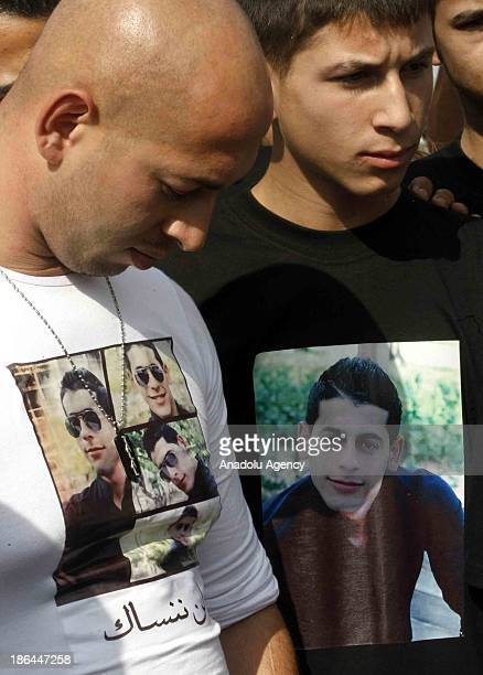 Relatives of 34 Lebanese drowned in the waters of Indonesia wait for their arrival at Rafik Hariri International Airport on October 31 2013 in Beirut...