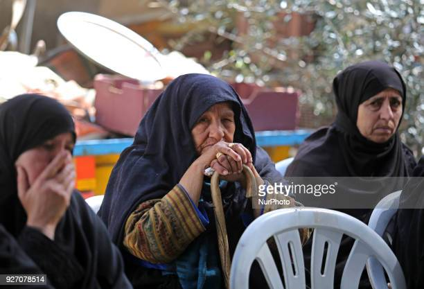 Relatives of 59yearold Palestinian farmer Muhammed Abu Jama mourn over his body during his funeral in the town of Khan Yunis in the southern Gaza...