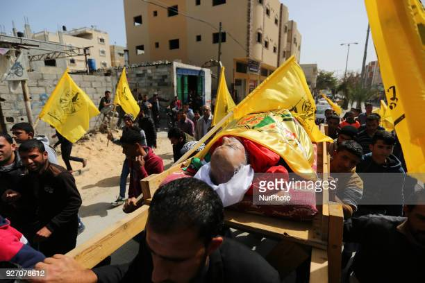 Image contains graphic content Relatives of 59yearold Palestinian farmer Muhammed Abu Jama mourn over his body during his funeral in the town of Khan...