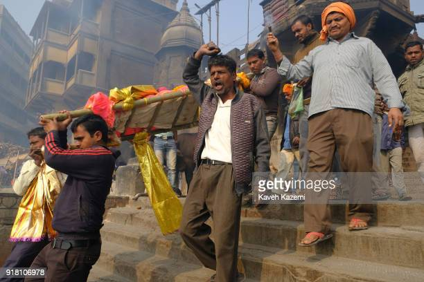Relatives of a deceased man carry his body to the cremation site in Manikarnika Ghat on January 28, 2018 in Varanasi, India. Manikarnika Ghat is one...