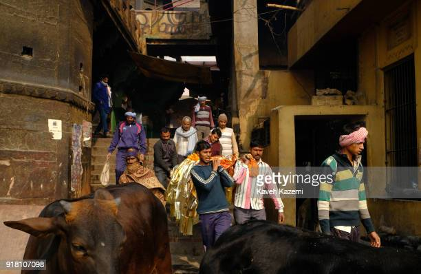 Relatives of a deceased man carry his body to the cremation site in Manikarnika Ghat on January 28 2018 in Varanasi India Manikarnika Ghat is one of...