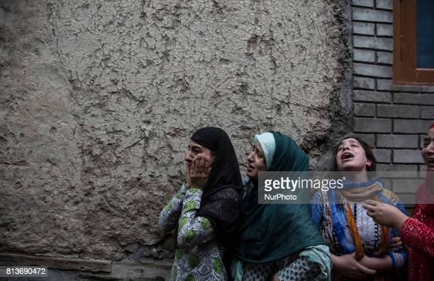 Relatives of a local rebel Sajad Gilkar wail during his funeral procession Wednesday July 12 2017 in Srinagar Indianadministered Kashmir India...