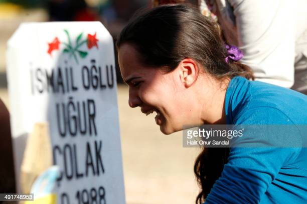 Relatives of a miner mourn beside his grave following the Soma mining disaster, on May 17, 2014 in Soma, Manisa, Turkey. Manisa Governorate has...