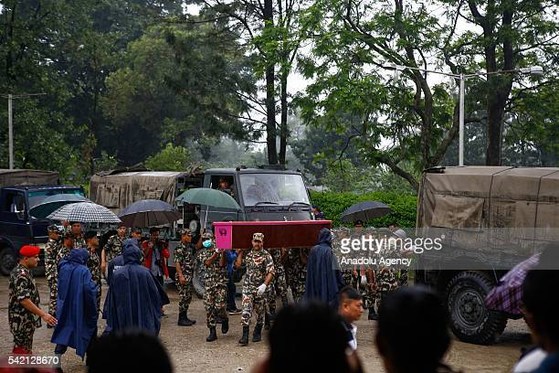 Relatives of a Nepalese security guards who was killed in Kabul suicide bombing mourn as the 12 dead bodies arrived at Tribhuvan International...
