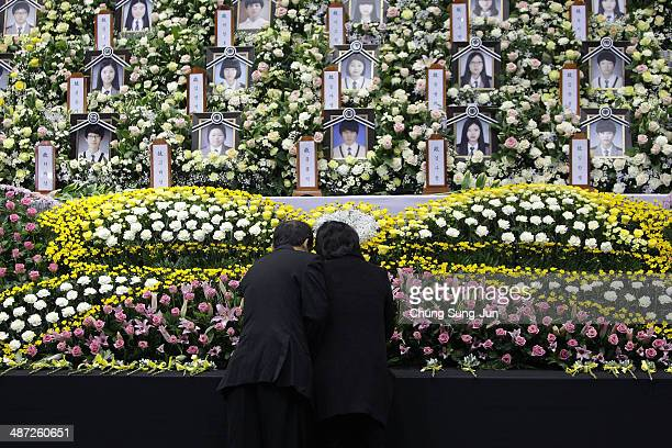 Relatives of a passenger of the sunken ferry Sewol weep as they pay tribute to the victims at Ansan city's official memorial altar at the Hwarang...