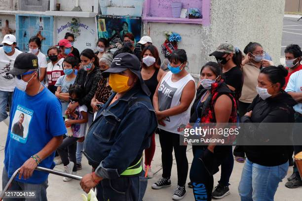 Relatives of a person who died from Coronavirus during the funeral before burying him in a niche of Nezahualcoyotl cemetery on June 2 2020 In Mexico...