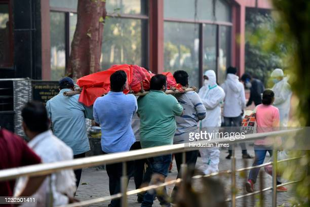 Relatives of a person who died of Covid-19 carry the body for cremation at Nigambodh Ghat crematorium, on April 24, 2021 in New Delhi, India.