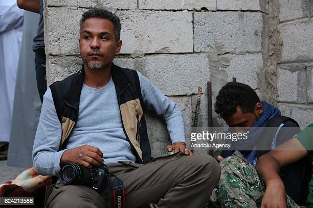 Relatives of a photojournalist Evab ezZebiri who was killed after the bomb exploded which had put into a disused building by Houthis mourn in front...