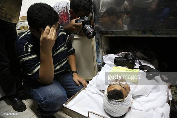 Relatives of a photojournalist Evab ezZebiri who was killed after the bomb exploded which had put into a disused building by Houthis mourn around the...