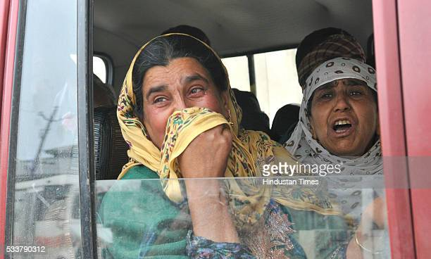 Relatives of a policeman who was killed by suspected militants grieve during a wreath laying ceremony at Police Control Room on May 23 2016 in...