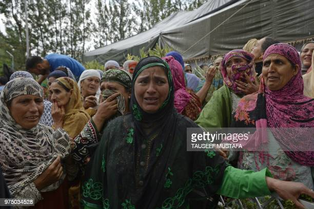 Relatives of a slain editorinchief of the Srinagarbased newspaper Rising Kashmir Shujaat Bukhari mourn during the funeral procession at Kreeri some...