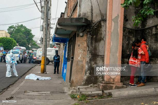 TOPSHOT Relatives of a student from Vicente Caceres Central Institute who was shot dead by alleged gang members when she was heading to class mourn...