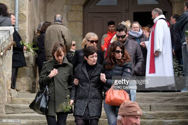 Relatives of a victim leave the service of remembrance at the Saint Etienne Church in Trebes in southwest France on March 25 two days after a man...