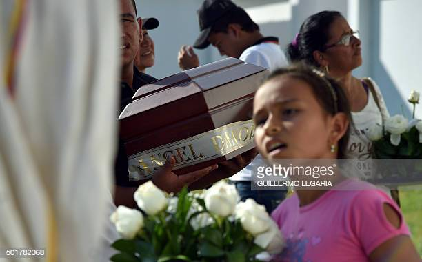 Relatives of a victim of the armed conflict in Colombia bury the remains of their loved one in the central cemetery of Villavicencio Meta department...