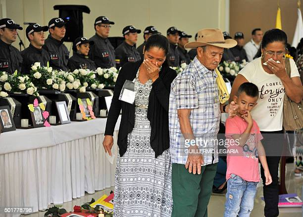 Relatives of a victim of the armed conflict in Colombia cry during a ceremony marking the dignified return of the remains in Villavicencio Meta...