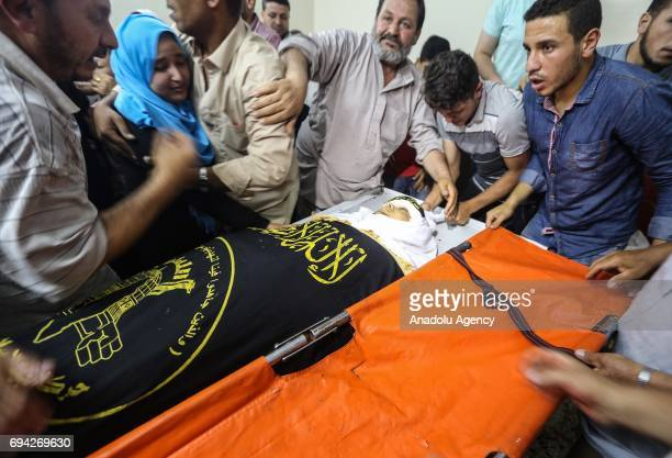 Relatives of Aed Khamis Jumaa shot dead by Israeli forces during a protest at Jabalia camp mourn over his dead body before the funeral in Jabalia...