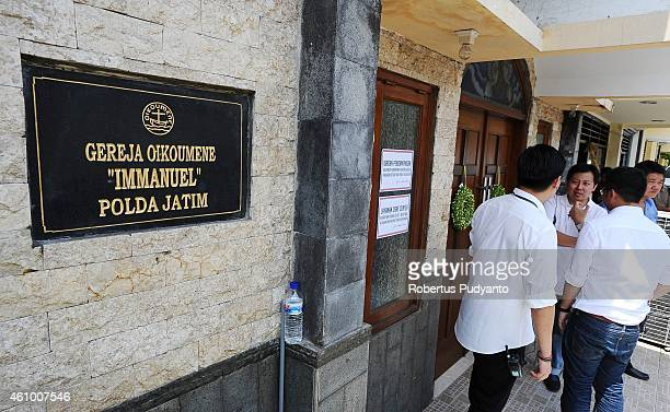 Relatives of AirAsia QZ8501 victims attend to a prayer service at Immanuel Oikoumene Church on January 4 2015 in Surabaya Indonesia A massive...