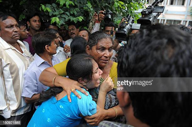 Relatives of an unidentified convicted Indian react inside the Trial Court compound in Ahmedabad on August 29 after the court decision. An Indian...