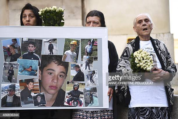Relatives of Antoine a 15yearold boy killed in Marseille in 2011 hold pictures of Antoine prior to the trial of his alleged murderer Jean Grabo on...