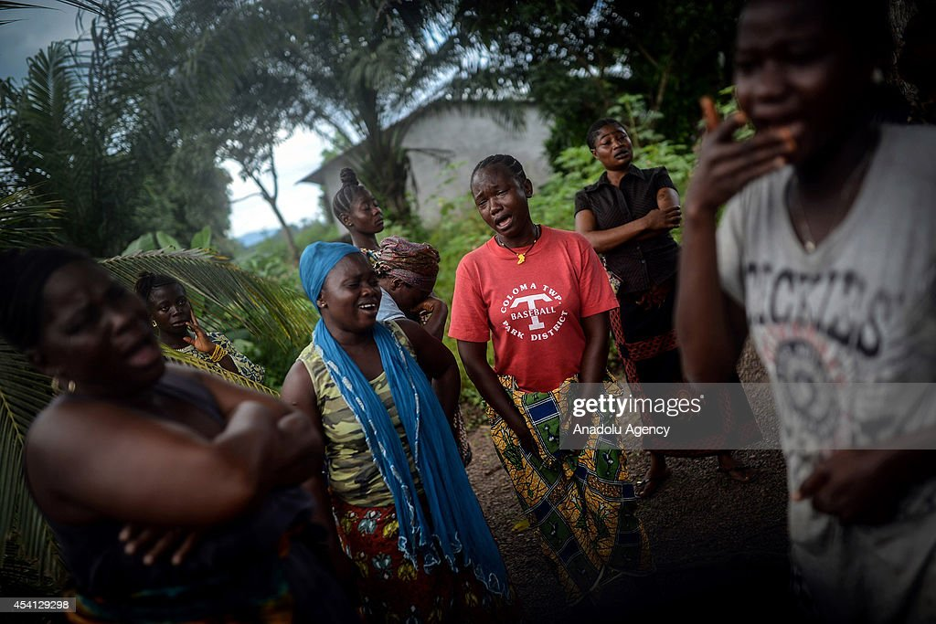 Relatives of Baindu Koruma (28) died due to the Ebola virus, mourn in Lango village, Kenema, Sierra Leone on August 25, 2014. Ebola, a contagious disease for which there is no known treatment or cure, has claimed hundreds of lives in Sierra Leone, Guinea and Liberia.