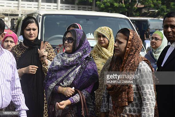 Relatives of Bangladeshi Army officers who were killed during a mutiny in 2009 arrive at the special court in Dhaka on November 5 2013 A Bangladeshi...