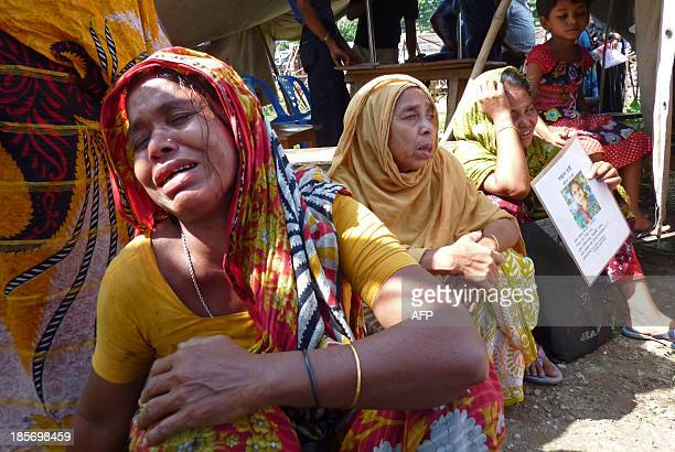 Relatives of Bangladeshi garment workers killed in the Rana Plaza garment factory building collapse react while gathered for a demonstration in...