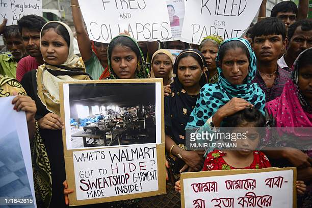 Relatives of Bangladeshi workers who lost their lives in a garment factory disaster, gather with banners and placards in Savar, on the outskirts of...