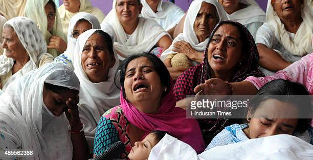 Relatives of Banso Devi who was killed in mortar shelling after mortar shell fired by Pakistan rangers at Sai village in Abdullia sector about 55 km...