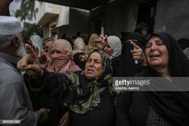 Relatives of Beha Abdurrahman Kadih who was killed after Israeli soldiers opened fire mourn during his funeral ceremony at Abasan alKabira town in...