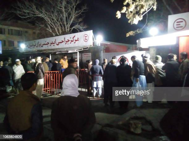 Relatives of blast victims gather outside a hospital of the Italian aid organisation 'Emergency' in Kabul on November 20 following a blast at a...
