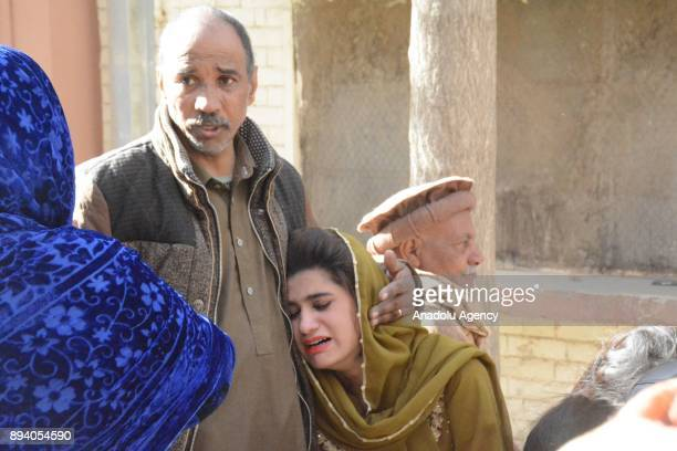 Relatives of bomb attack victims mourn after their dead bodies are taken to a hospital following a suicide attack at Bethel Memorial Methodist Church...