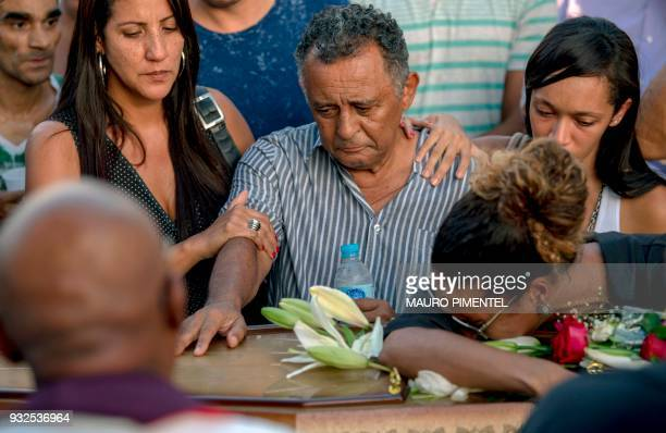 Relatives of Brazilian councilwoman and activist Marielle Franco pay tribute during her funeral at Caju Cemetery in Rio de Janeiro Brazil on March 15...