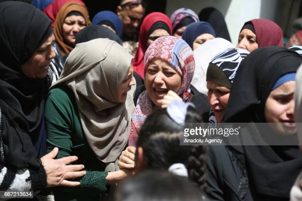 Relatives of Casim Mohammed Nahli who was killed by Israeli forces mourn during a funeral ceremony at a refugee camp in Ramallah West Bank on April...