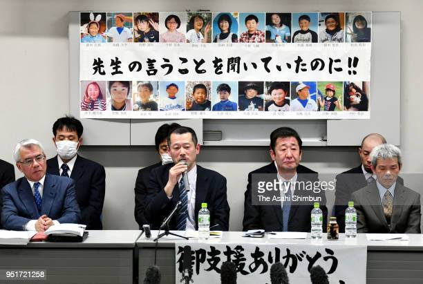 Relatives of children killed in the 2011 tsunami attend a press conference following the Sendai High Court's ruling on April 26 2018 in Sendai Miyagi...