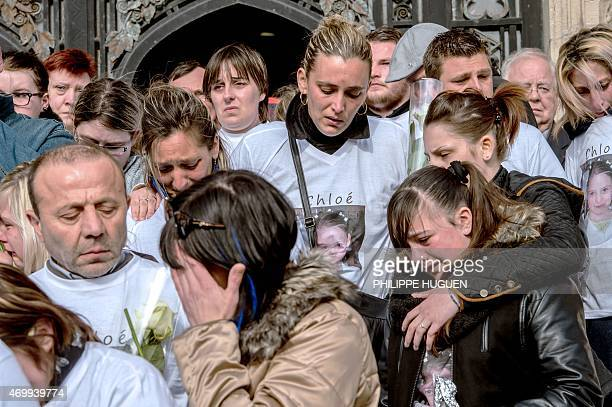 Relatives of Chloe a nineyearold girl who was killed a day before leave the city hall on April 16 2015 in Calais northern France A Polish man has...