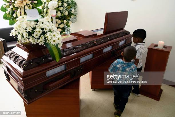 Relatives of Colombian social leader Libardo Moreno who was murdered last July 23 in a rural area of Jamundi mourn during his funeral in Cali...