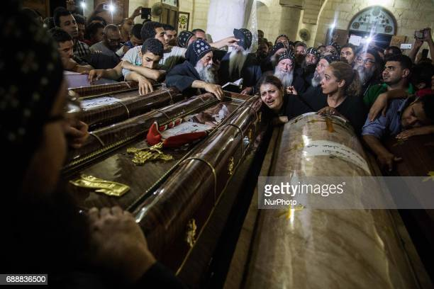 Relatives of Coptic Christians who were killed during a bus attack surround their coffins during their funeral service at Ava Samuel desert monastery...