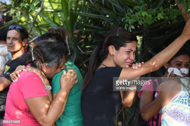 VALENCIA CARABOBO VENEZUELA Relatives of detainees seen comforting each other by hugging Relatives of detainees in the police headquarters of...