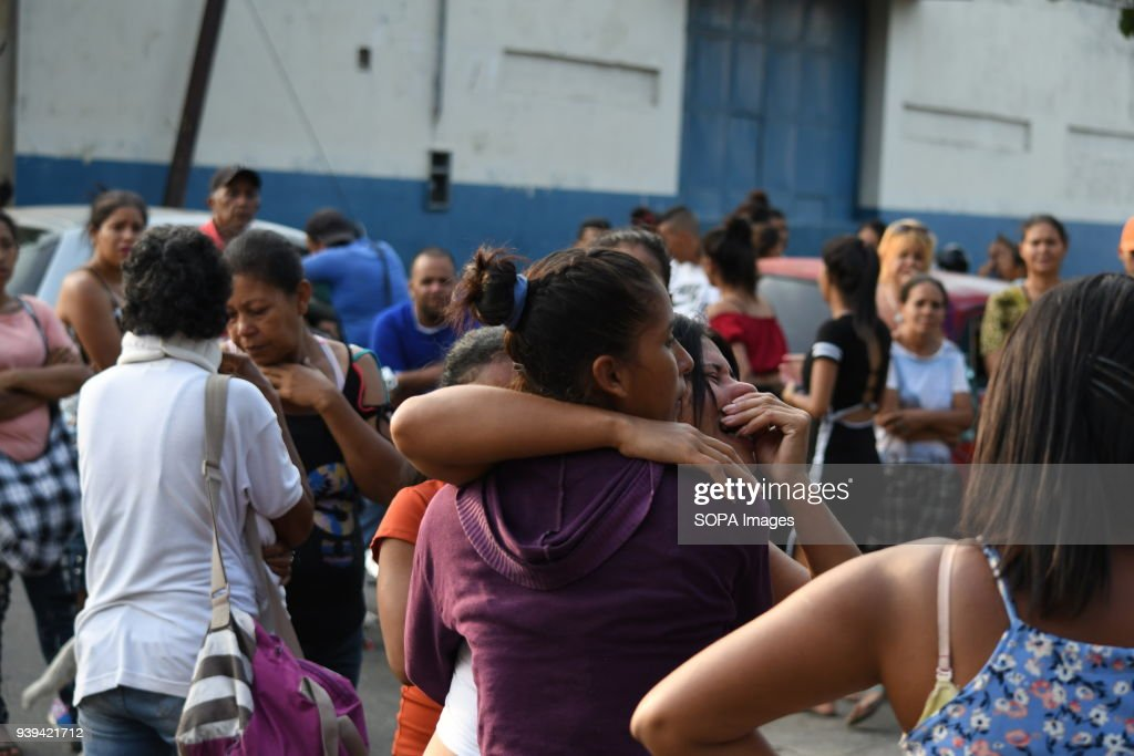 Relatives of detainees seen comforting each other by hugging... : News Photo
