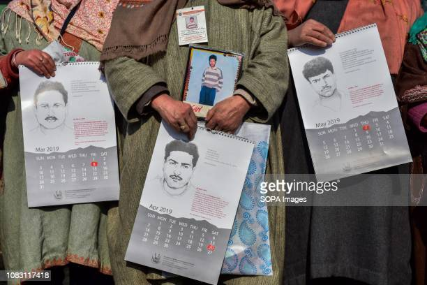Relatives of disappeared persons hold calendars during a calendar release in Srinagar Indian administered Kashmir Since January 2016 the Association...