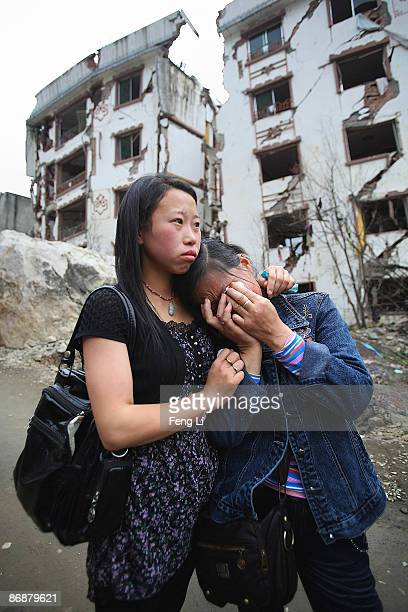 Relatives of earthquake victims cry as they mourn at the ruins of earthquakehit Beichuan county on May 10 2009 in Mianyang of Sichuan Province China...