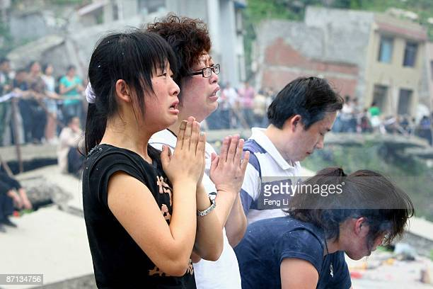 Relatives of earthquake victims cry as they mourn at the ruins of earthquakehit Beichuan county during the one year anniversary of the Wenchuan...